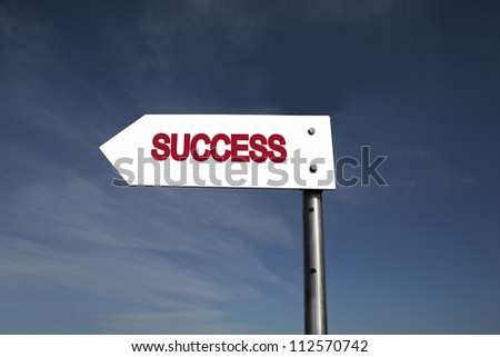 Signboard with the word success on a blue sky