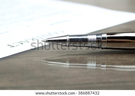 signing a contract, business contract details - stock photo