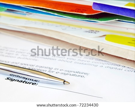 Signing a contract. Focus is on the signature and pen. - stock photo