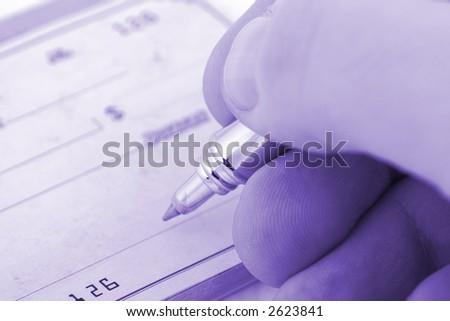 signing check close up with shallow depth of field - stock photo
