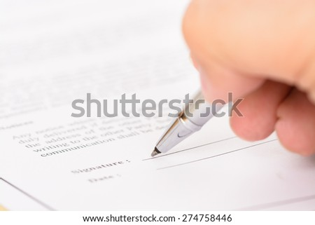 Signing contract form - stock photo