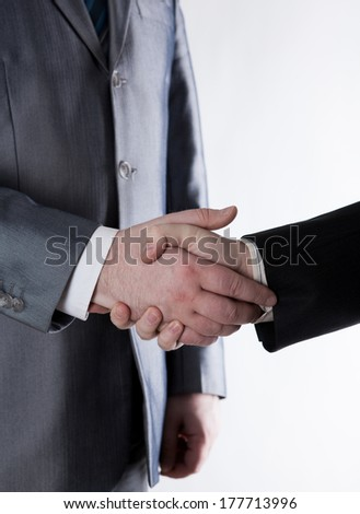 signing of the agreement and a handshake on white background