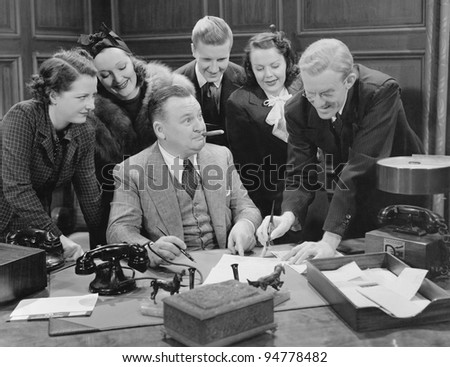 Signing on the dotted line - stock photo