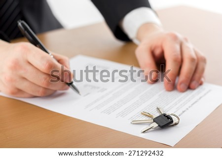 Signing papers. Lawyer, realtor, businessman sign documents. real estate. copy space