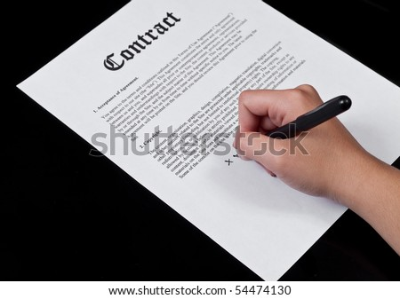 Signing the Contract - stock photo