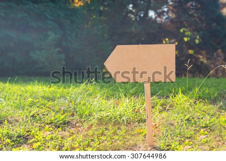 signpost in the grass - stock photo