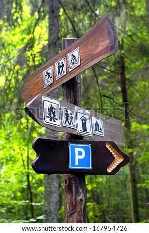 Signpost  on hiking trail describing hiking routes etc.. - stock photo