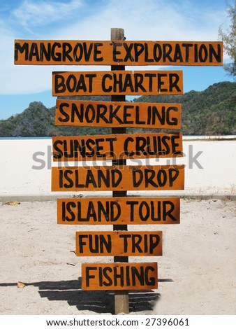 Signpost on the famous Tanjung Rhu beach of Langkawi, Malaysia - stock photo