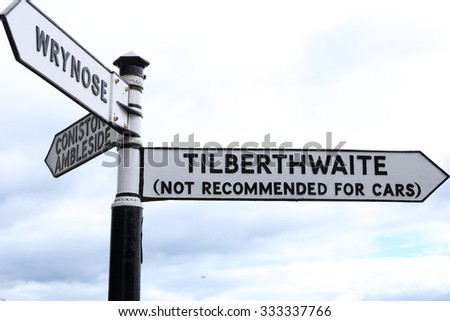 Signpost showing direction to Tilberthwaite, but not recommended for cars, in the English Lake District, Cumbria. - stock photo