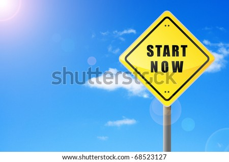Signpost start now on sky background. - stock photo
