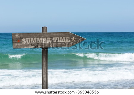 signpost summer and holiday landscape in the background