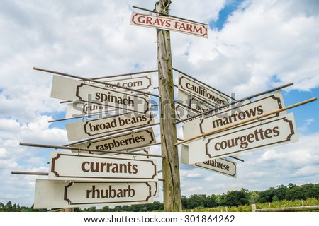 Signpost to many vegetables and fruits on a pick-your-own farm  - stock photo