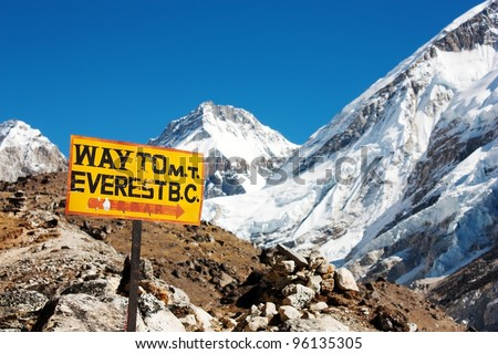 signpost way to mount everest b.c. and himalayan panorama - stock photo