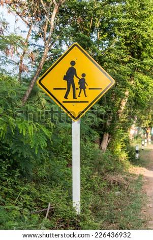 Signs Beware of pedestrians - stock photo