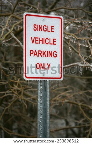 Signs covered in ice from winter ice storm - stock photo