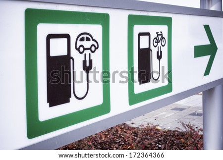 signs for a power supply for electric bikes and cars - stock photo