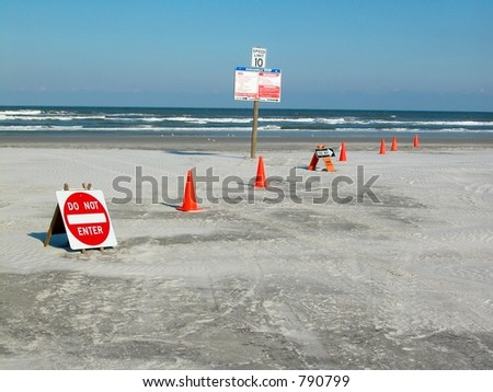 Signs for traffic flow on a beach - stock photo