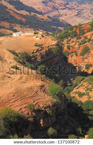 Signs of erosion on a valley in Atlas mountains, Morocco