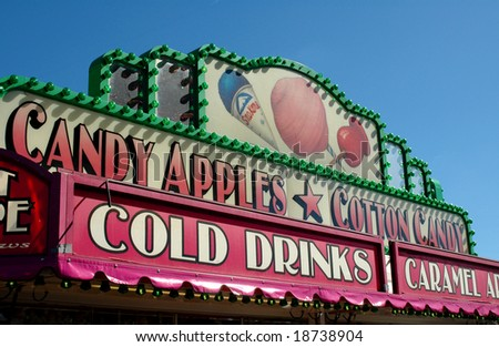 Signs on top of a food stand at a county fair - stock photo