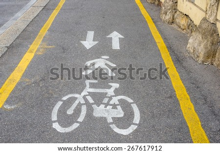 Signs Painted on the Asphalt of a Pedestrian and Bicycle Lane - stock photo