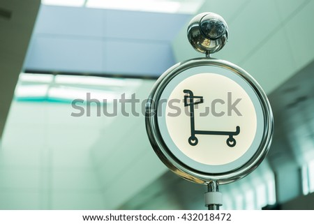 Signs symbols trolley Signs sphere in an airport. - stock photo