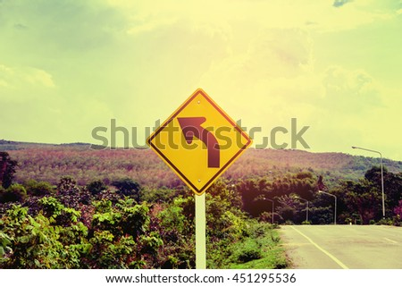Signs Traffic turning left on sky background,  road sign of turn left yellow background and black arrow