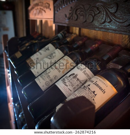 SIHANOUKVILLE, CAMBODIA - MARCH 06, 2015: European traditional shelves with wine bottles in Otres beach bar in Sihanoukville, Cambodia.