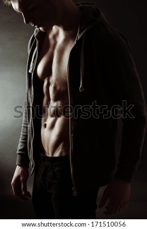Sihouette of a fit man in a jacket - stock photo