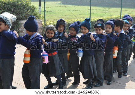 SIKANDRA, INDIA - DEC 16: School kids at a field outing in Sikandra, India, as seen on Dec 16, 2011. - stock photo