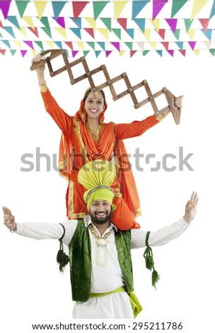 Sikh couple enjoying themselves - stock photo