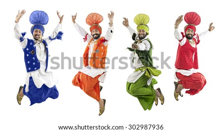 Sikh men jumping in the air - stock photo