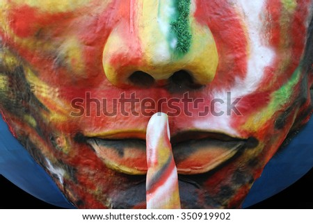 Silence please. Structure of man with finger on his lips as gesture representing silence. - stock photo