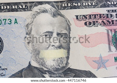 Silent president, portrait of the American leader Ulysses Grant with mouth glued on the banknote of fifty dollars USA, as a symbol of the instability of the economy system