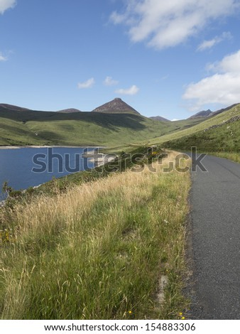 silent valley reservoir with Doan mountain in the background - stock photo