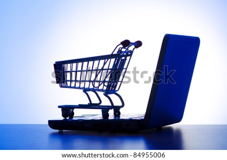Silhoette of laptop and shopping cart - stock photo