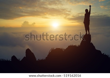 silhouette achievements successful arm up man is celebrating success with sunrise.