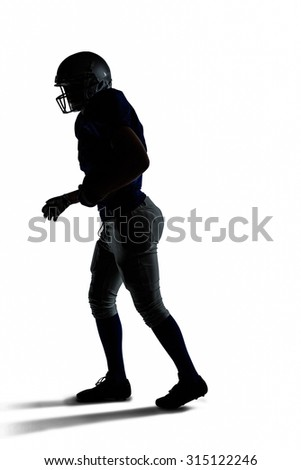 Silhouette American football player walking against white background