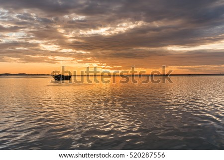 Silhouette, Beautiful seascape sunset with overcast natural background texture