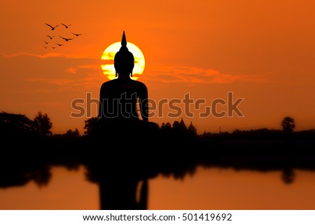 Silhouette Big Buddha statue on sunset