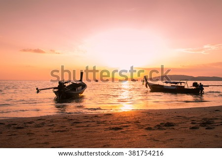 silhouette boat during sunset for journey to island trips - stock photo