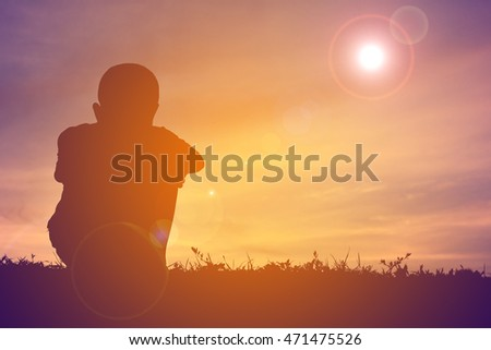 Silhouette boy alone in sunset