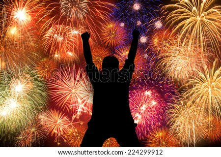 Silhouette boy happy enjoy brightly colorful fireworks in the night sky