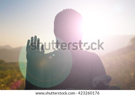 Silhouette Buddha Sky evening blurred bokeh background. Inspiration creativity mystery peaceful gentle dedicated advancement Buddha Purnima Vesak Full Moon Poya Day Visakha Bucha Visak Bochea - stock photo
