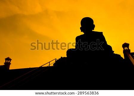 Silhouette Buddha Statue - stock photo
