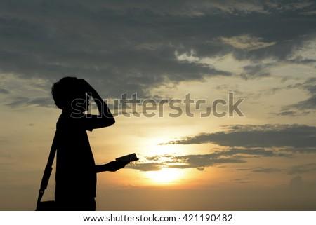 Silhouette businessmen  no idea.Background sunset over the sea - stock photo