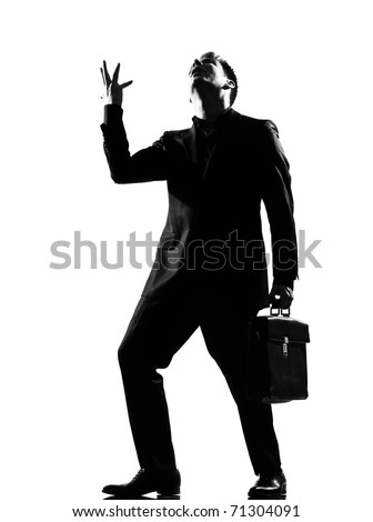 silhouette caucasian business man  expressing anger adversity despair looking up behavior full length on studio isolated white background - stock photo