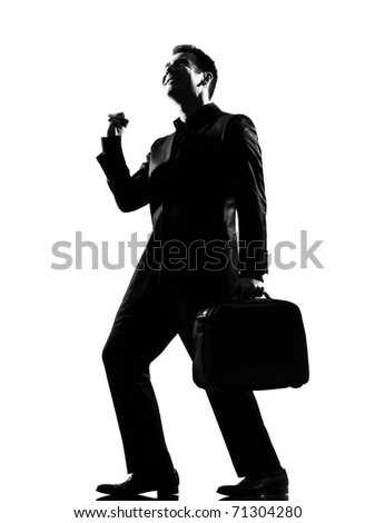 silhouette caucasian business man  expressing happy joy winning behavior full length on studio isolated white background - stock photo