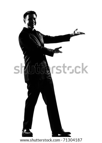 silhouette caucasian business man  expressing  showing gesture introducing presentationsimiling  behavior full length on studio isolated white background - stock photo