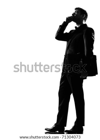 silhouette caucasian business man on the phone expressing behavior full length on studio isolated white background