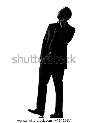 silhouette caucasian business man on the phone expressing behavior full length on studio isolated white background - stock photo